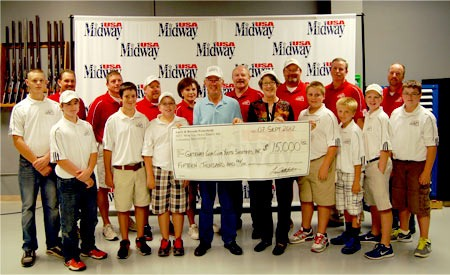 MidwayUSA owners Larry and Brenda Potterfield (center) with members from the Gateway Gun Club Youth Shooters