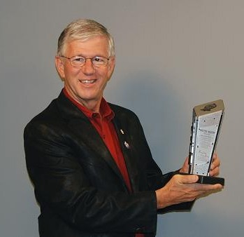 Larry Potterfield with the 2011 Shooting Industry Academy of Excellence Award 