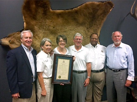 Larry and Brenda Potterfield pictured (Left to Right) with Jim Blair and MDC Commissioners Becky Plattner, Don Johnson and Don Bedell at MidwayUSA on July 12, 2012.