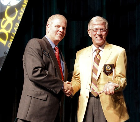 Past DSC President George Chamblee (Left)  presenting the sponsorship appreciation plaque to  Larry Potterfield, Founder and CEO of MidwayUSA, at the 2011 DSC convention.