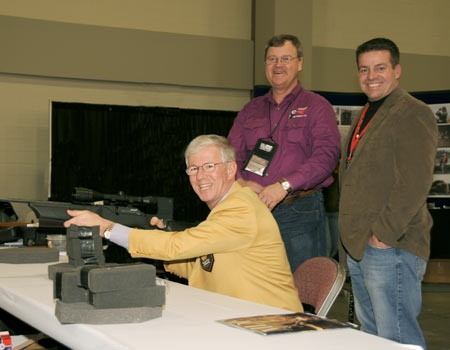 Larry Potterfield (seated), Founder and CEO of MidwayUSA, with Eric Tyksen of MDF (right) and Rocky Mraz from Real Time Targets