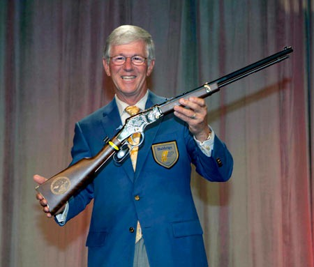 Founder and CEO Larry Potterfield shown with a Boy Scouts of America Centennial Edition Henry Repeating Arms Golden Boy, presented to him by Assistant Chief Scout Executive Brad Farmer (not pictured)