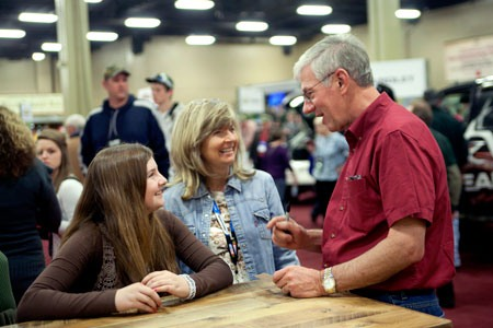 MidwayUSA Founder and CEO Larry Potterfield visiting with a future turkey hunter at the 2012 Convention