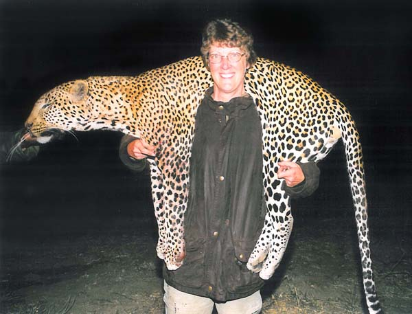 It doesn't get much better than this – a huge leopard and a happy hunter.