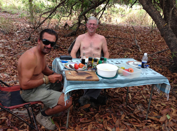 This was an early December safari, and it was so hot that we took off our shirts to cool down at lunchtime.  PH Nicolas Dubich on the left.