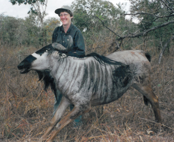Brenda with the wildebeest; what an unusual picture!