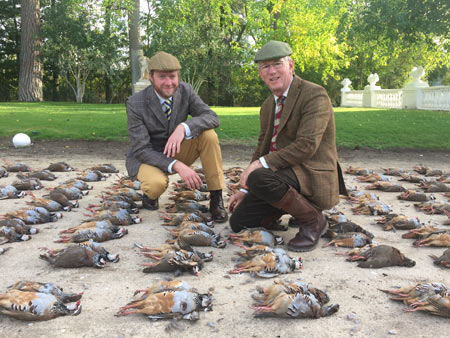 At the end of day one, they neatly displayed the day's shoot of red-legged partridges – for formal pictures. Son Russell on the left.