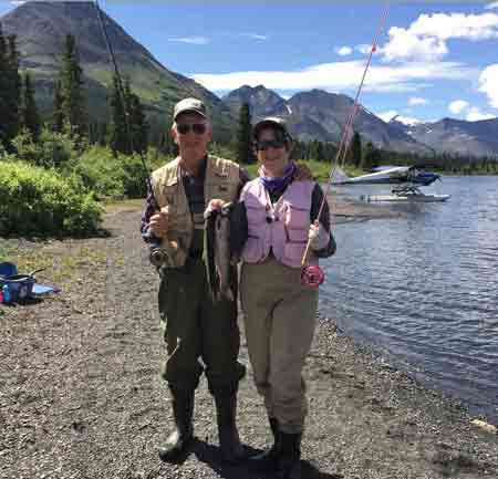 Shore lunch isn't just a picnic lunch; in this case it includes two fresh rainbow trout.  Brenda caught both of these.  Please notice the sheer beauty of the place.