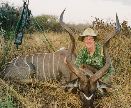 End of the hunt; Brenda with the skulls and horns of her greater and lesser kudu, taken on the same hunt - 7 days apart. Both are mature male animals, but quite different in size.