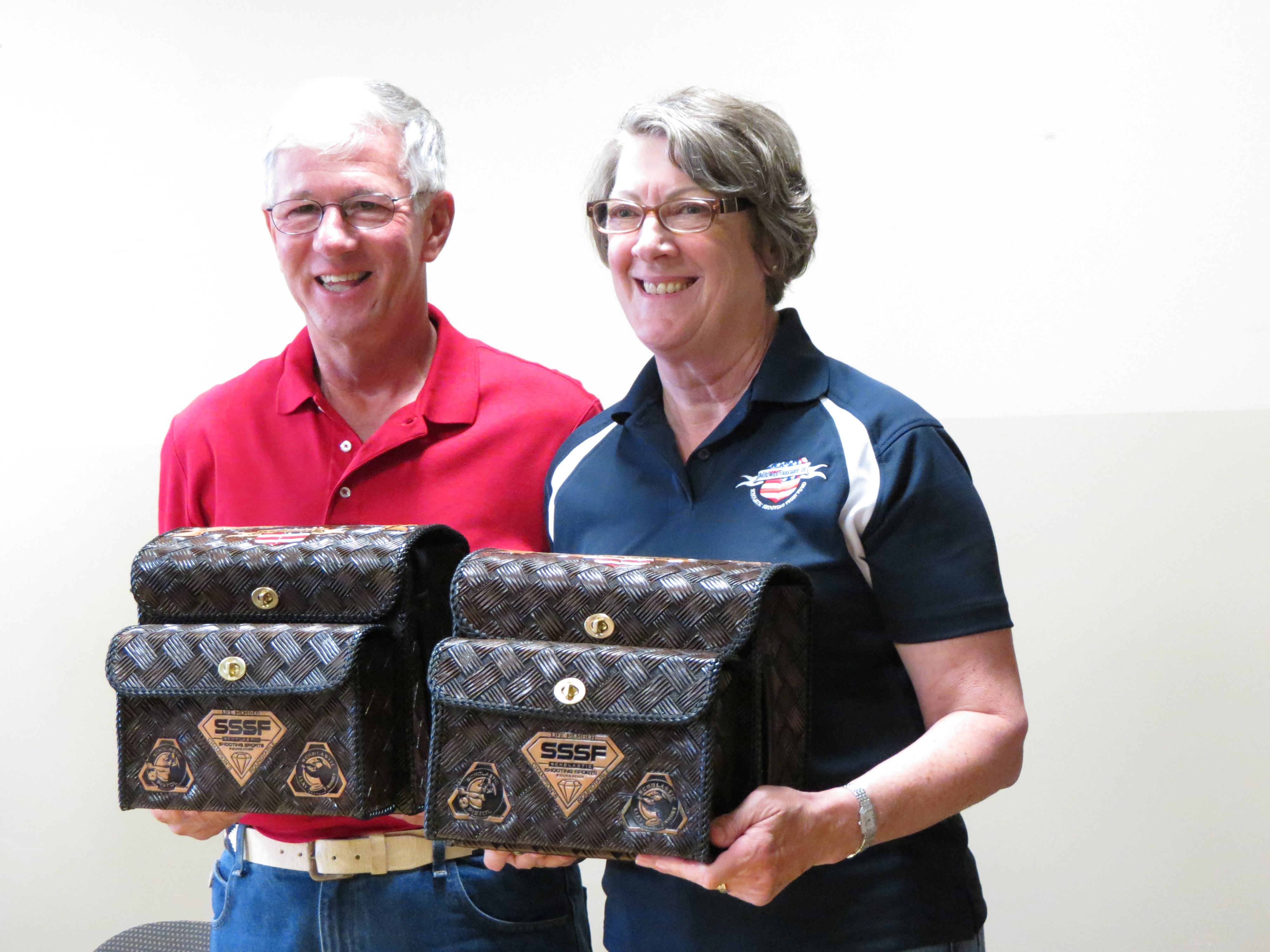 Larry and Brenda Potterfield after being presented with custom Shamrock Leathers shell bags