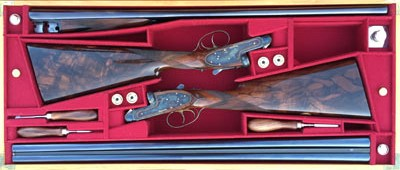 "A matched pair of Purdey side by sides - the epitome of ""best guns"""