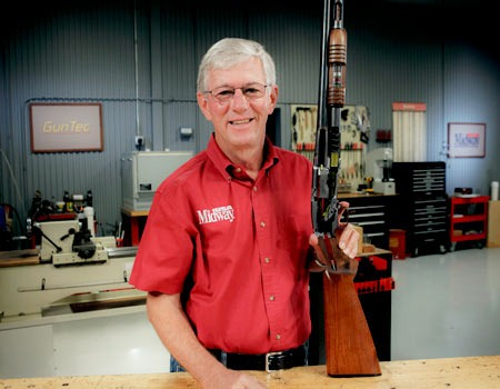 MidwayUSA Founder and CEO Larry Potterfield with Model 12 Pump Shotgun Cutaway