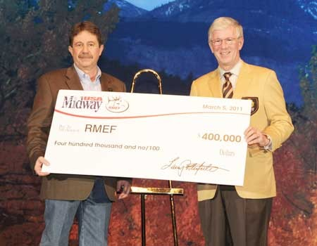Larry Potterfield (right), presenting David Allen, President and CEO of RMEF, with a donation to support the creation of the SAFE Challenge Program at the 2011 RMEF Convention.