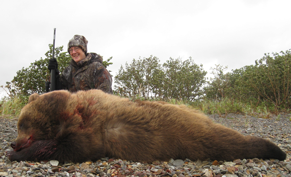 "Brenda with her large Alaska Brown Bear, that will square 9' 6""."