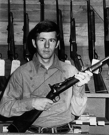 I'm holding a U.S. Springfield Trapdoor, Saddle Ring Carbine in 45/70; you can see some of our display of new guns in the background. (fall, 1982)