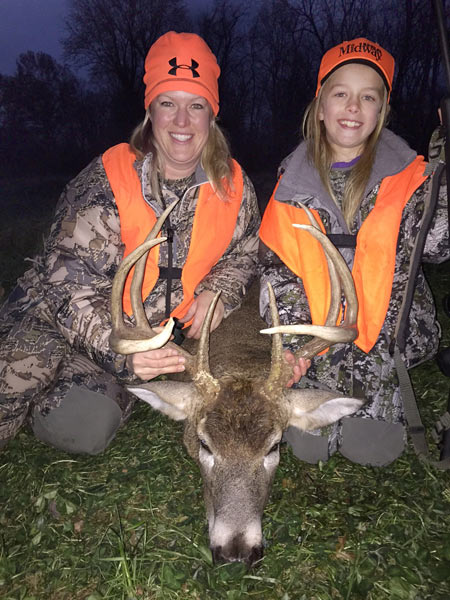 Mom (Sara) with nine year old daughter Eliza and her first buck.