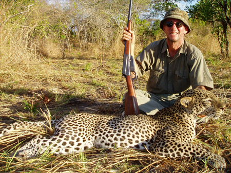 I swapped the 375 H&H for my Winchester 1895 in the 405, as we walked up on the dead leopard.