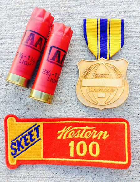 The ammunition companies have long offered  patches like this,  so shooters can display their  accomplishments.  The medal was for first place in 12 gauge 'C' class.