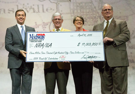 The 2015 ceremonial check presentation,  Chris Cox Executive Director of NRA-ILA on the left,  Jim Porter, NRA President on the right.