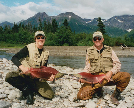These sockeye salmon are well past their prime and from a fisherman's perspective are mostly just good for hauling in and taking pictures. Brenda and I pose, with some beautiful Alaska scenery in the background.