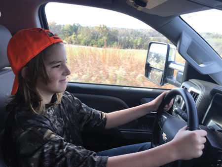 Twelve years old and driving a car for the first time —grandpa's pickup on the farm road; pretty cool stuff!