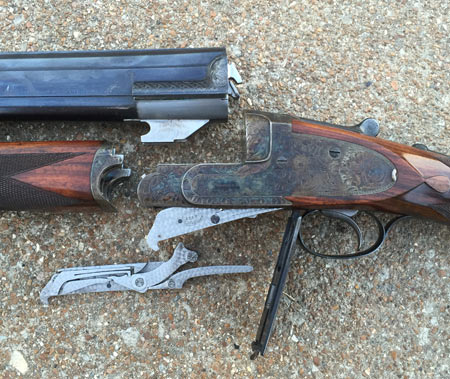 This Westley Richards 'Ovundu' model features droplocks.  The right lock has been 'dropped out' and you can see the hammer, sear and mainspring.  The left lock is only partially removed.  The only parts left inside the action are the firing pins and the trigger.