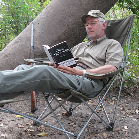 A safari in Africa provides a lot of time to catch up on reading – on the trip over and back, and during the long mid-day breaks – under the lunch tree.