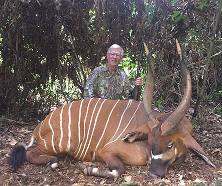 Larry with his 'first day' bongo, from deep in the Cameroon jungle. His rifle is The Nearly Perfect Safari Rifle; 375 H&H, with a 30mm Leupold VX-7 1.5x -6x.  At 10 steps, on 1.5 x, the field of view is very generous.