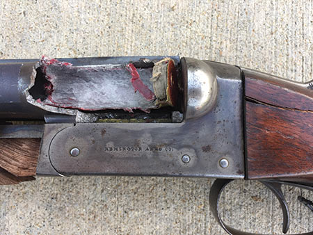 Remington 1900 12 gauge side by side with Damascus barrels.  This gun was intentionally destroyed with a gross overcharge of smokeless powder.  Such a charge would have destroyed any modern shotgun.