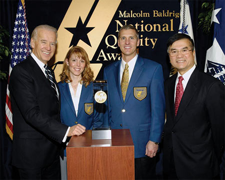 Brenda and I chose Matt Fleming and Deanna Herwald to represent the Company on the stage with Vice-President Biden and Secretary Locke –  a great memory for each of them.