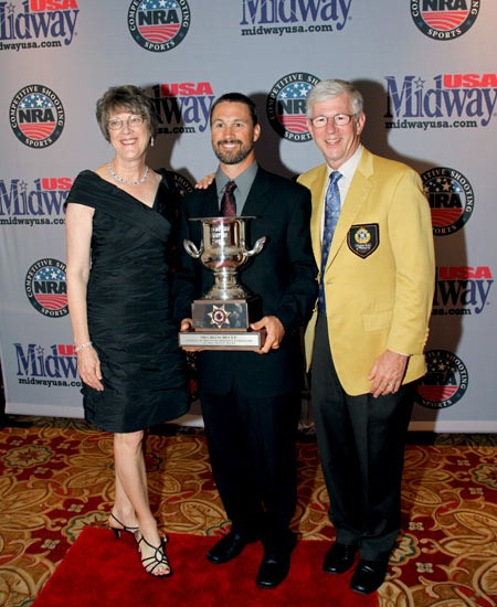 MidwayUSA owners Larry and Brenda Potterfield with Doug Koenig (center) at the 2011 Bianchi Cup Awards Ceremony