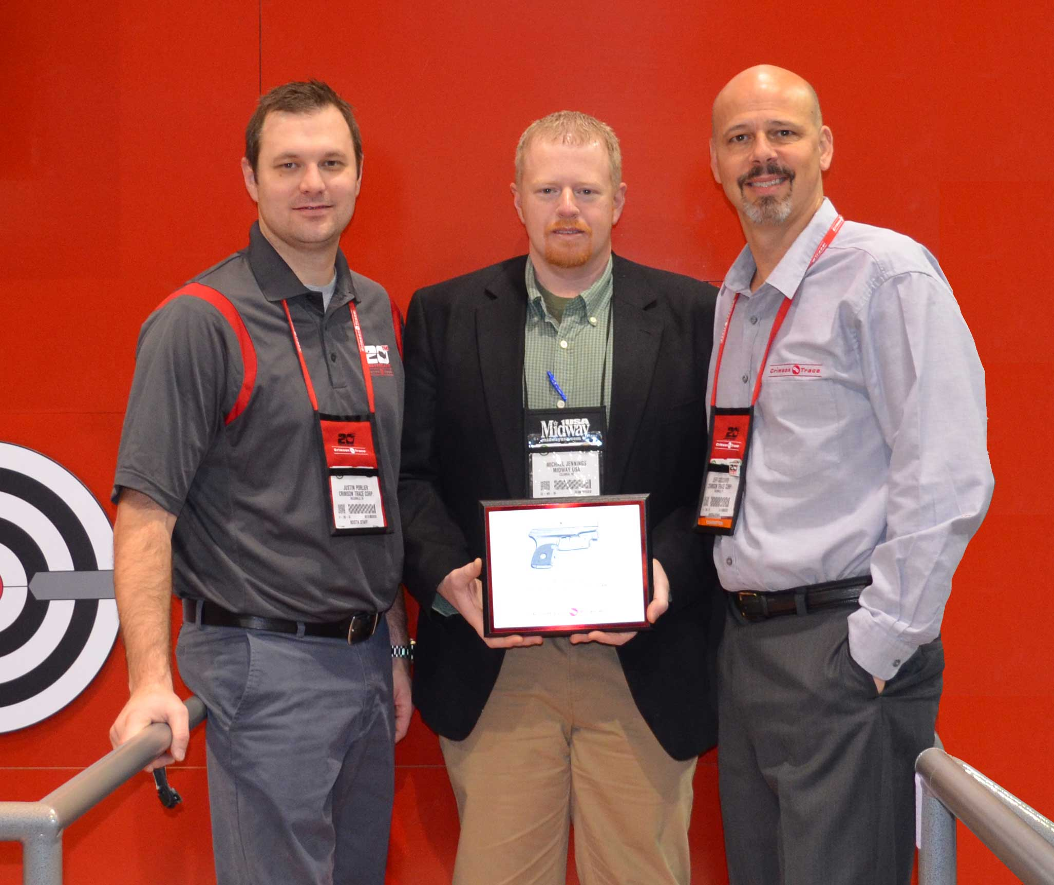 Crimson Trace Presenting Michael Jennings, MidwayUSA Optics Product Line Manager, with Elite Retailer of the Year Award