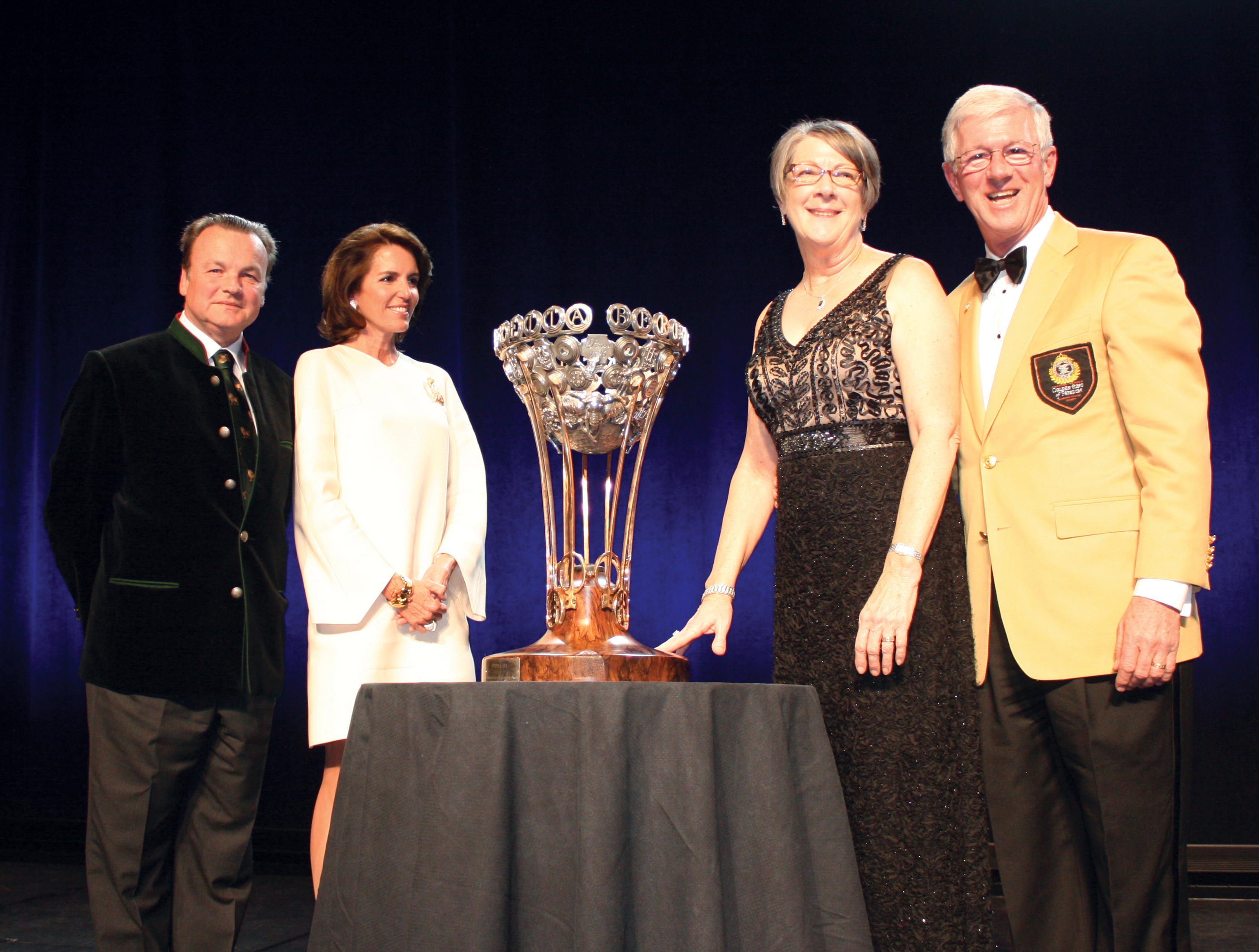 Larry and Brenda Potterfield Receiving the 2015 Beretta and SCI Foundation Conservation Leadership Award Trophy from Pietro Gussalli Beretta and his wife Gretchen Gussalli Beretta Harnischfeyger