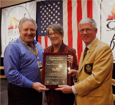 Howard Vincent, President and CEO of Pheasants Forever, Inc., with Larry and Brenda Potterfield, founders of MidwayUSA