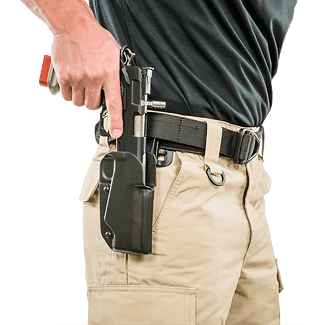 Man drawing gun from holster